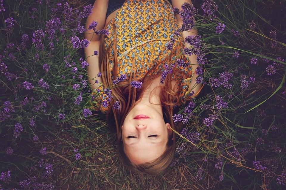 Woman Sleeping On Lavender Plants
